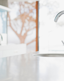 How frequently should I clean the kitchen faucet